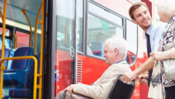 Photo: Man helping an elderly man in a wheelchair to get into the bus; Copyright: EDF