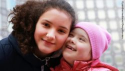Photo: Two sisters, one with the down syndrome; Copyright: panthermedia.net/DenysKuvaiev