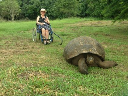 Photo: Woman with Galápagos giant tortoise; © Ecuadorforall
