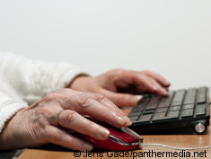 Photo: Elderly woman at the computer