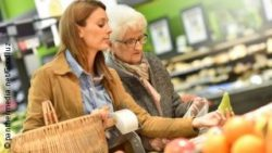 Photo: Elderly woman and a younger woman buying some fruits in the supermarket
