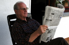Photo: Senior reads newspaper