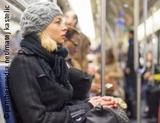 Photo: Woman sitting in the subway