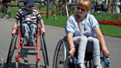 Photo: Two teenagers in their wheelchairs; Copyright: private