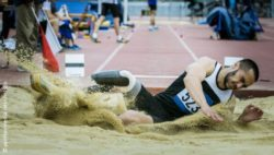 Photo: Long jumper with a prosthesis while landing in the sand; Copyright: panthermedia.net/chelsdo