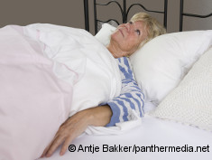 Photo: Elderly woman lying in her bed