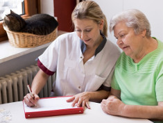 Photo: Nurse with an elderly woman