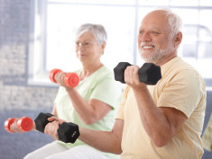 Photo: Elderly man and woman doing dumbbell training