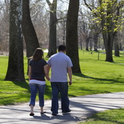 Photo: A couple walking in a park