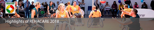Photo: Several men and women playing wheelchair basketball in the Sports Center at REHACARE; Copyright: Messe Düsseldorf