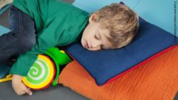 Photo: Boy fell asleep after playing; Copyright: panthermedia.net/SimpleFoto