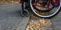 Photo: Wheelchair which crosses a curbside
