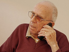 Photo: Old man on the phone