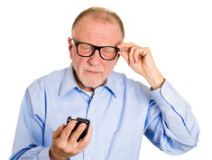 Photo: Man with glasses looking at a smartphone