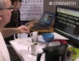 Photo: Man with a cup of tea using COGWATCH