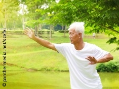 Photo: Elderly man doing Tai Chi