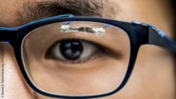 Photo: Student wearing the tissue paper sensor on his glasses; Copyright: Dennis R. Wise/University of Washington