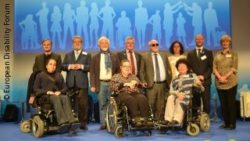 Photo: People are standing on the stage; Copyright: European Disability Forum