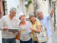 Photo: Four seniors travelers during sightseeing