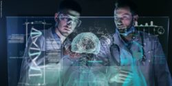 Photo: two doctors standing in front of a virtual screen depicting human organs; Copyright: panthermedia.net/hquality