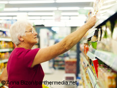 Photo: Elderly woman with glasses in a supermarket