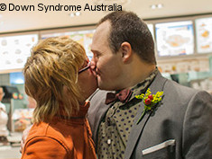 Photo: Two people with Down Syndrome kissing