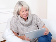 Photo: Elderly woman with tablet