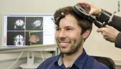 Photo: Man during a Transcranial Magnetic Stimulation (TMS); Copyright: MPI CBS