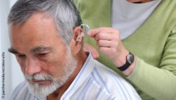 Photo: Elderly man getting his hearing aid; Copyright: panthermedia.net/alexraths