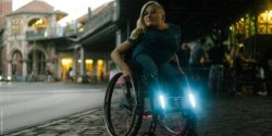 Photo: Young woman in a wheelchair with attached blue and red lights; Copyright: be able e.V./Jonas Schubert