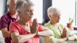 Photo: Elderly people during a yoga session; Copyright: PantherMedia/Wavebreakmedia ltd