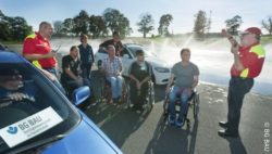 Photo: People with disabilities are at a training area for driver safety training; Copyright: BG BAU