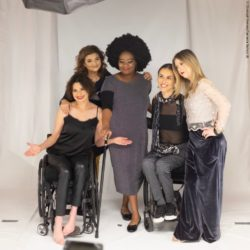 Photo: Various models at the photo shoot. Two women in wheelchairs, a young woman with trisomy 21 and a female plus-size model; Copyright: Christoph Klemens/Samanta Bullock SB