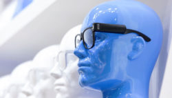 Photo: Blue plastic head with virtual reality glasses