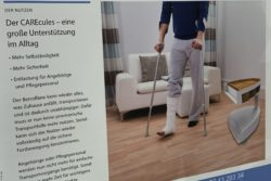 Photo: Information poster about CAREcules at the stand of Varomo AG at REHACARE 2019; Copyright: beta-web