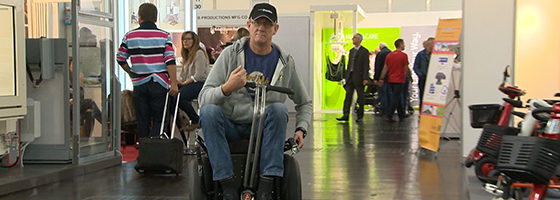 Photo: Man using a Segway wheelchair; Copyright: REHACARE.com