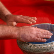 Photo: hands playing a drum