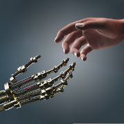 Photo: Robot and human reaching hands