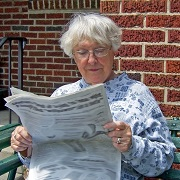 Photo: Old woman reading the newspaper