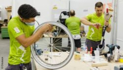 Photo: Three technicians working on different auxiliary means in the Ottobock workshop during Rio 2016; Copyright: Ottobock