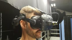Photo: man is wearing a VR device to stimulate sight loss; Copyright: Dr Peter Jones, City, University of London