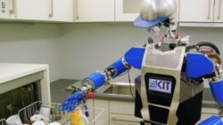 Photo: Humanoid robot clears out dishwasher; Copyright: KIT