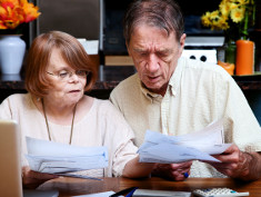 Photo: Elderly couple and financial documents
