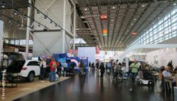 Photo: Hallway at REHACARE with people and exhibitors; Copyright: Heiduk