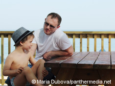 Photo: Father talking to his son