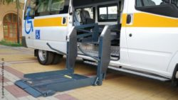 Photo: An accessible bus for the transport of people with disabilities. The hydraulic ramp is on the ground; Copyright: panthermedia.net/Valeriy_Al