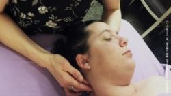 Photo: Massage therapist rubs patient's neck; Copyright: School of Health and Rehabilitation Sciences