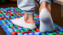 Photo: Feet on a carpet with different surfaces in a rehabilitation room; Copyright: panthermedia.net/LogvinyukYuliia