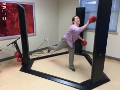 Photo: Woman doing an exergame