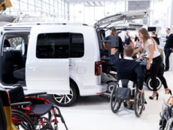 Photo: Exhibitors in the field of adaptation of cars talking at REHACARE